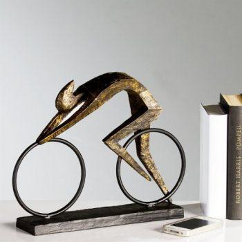 DESIGN-SKULPTUR-RACER-von-XTRADEFACTORY-Rennradfahrer-Radfahrer-in-bronze-Optik-0