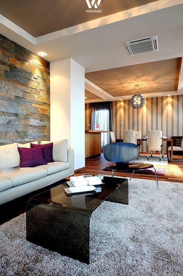 Eine kreative Wandgestaltung wertet auch das Wohnzimmer auf ...