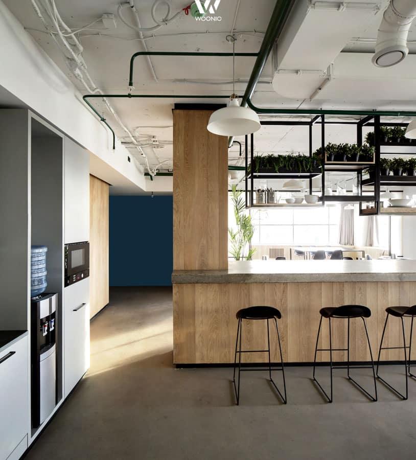 Küchenblock mit bar  Der Küchenblock dient sowohl als Bar als auch zur Trennung zwischen ...